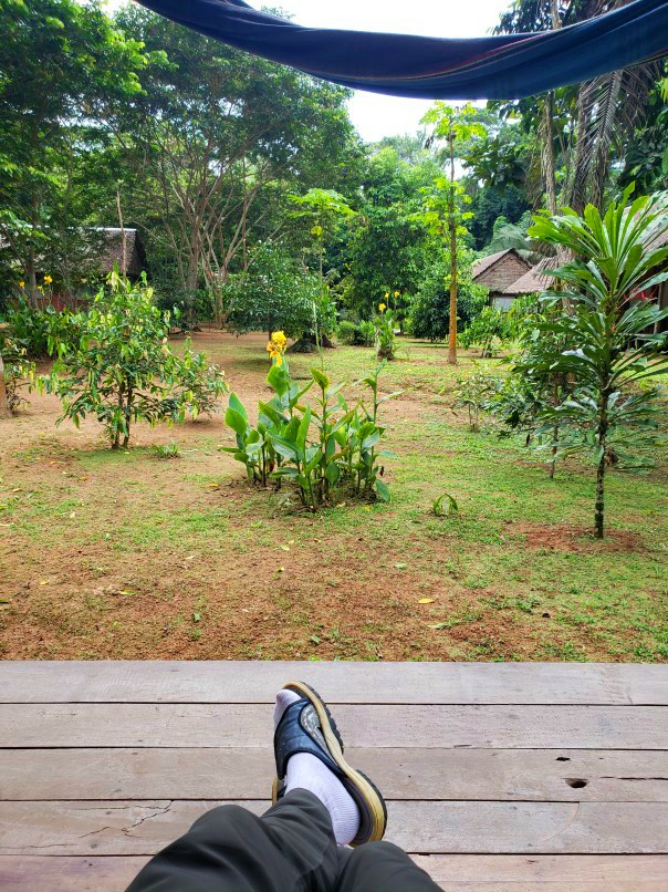 relaxing with feet up at the Amazon Lodge in Bolivia