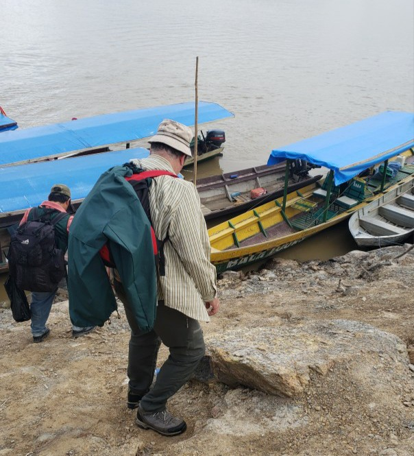 walking down a hill to board a boat in the river in Bolivia