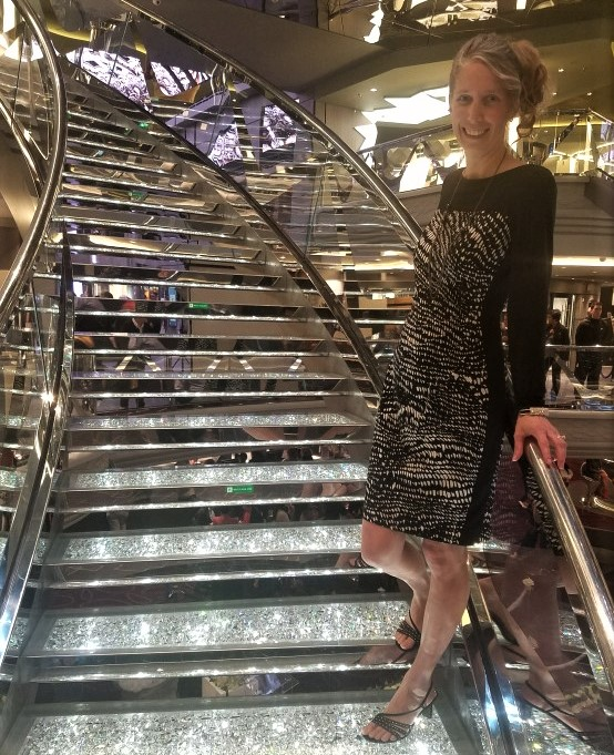 posing on sparkly staircase in cruiseline lobby