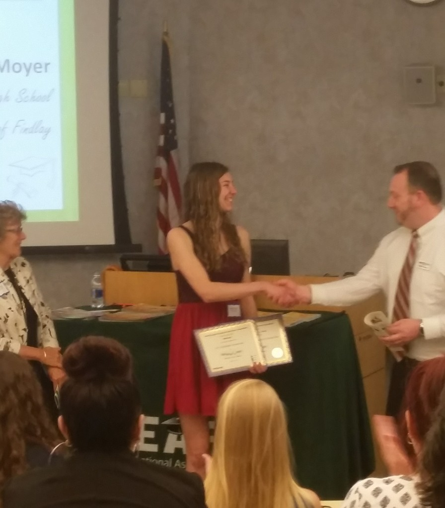 shaking hands after winning a scholarship from erie bank