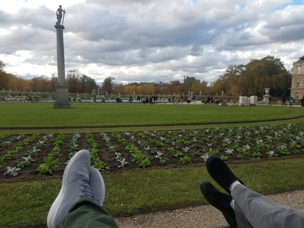 Relaxing on the green chairs in Luxembourg Gardens