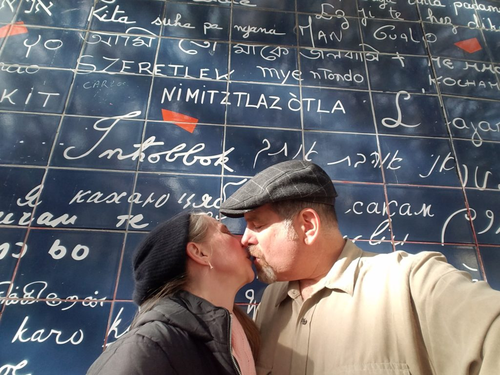 smoching at the I love you wall in Paris on a two-day tour