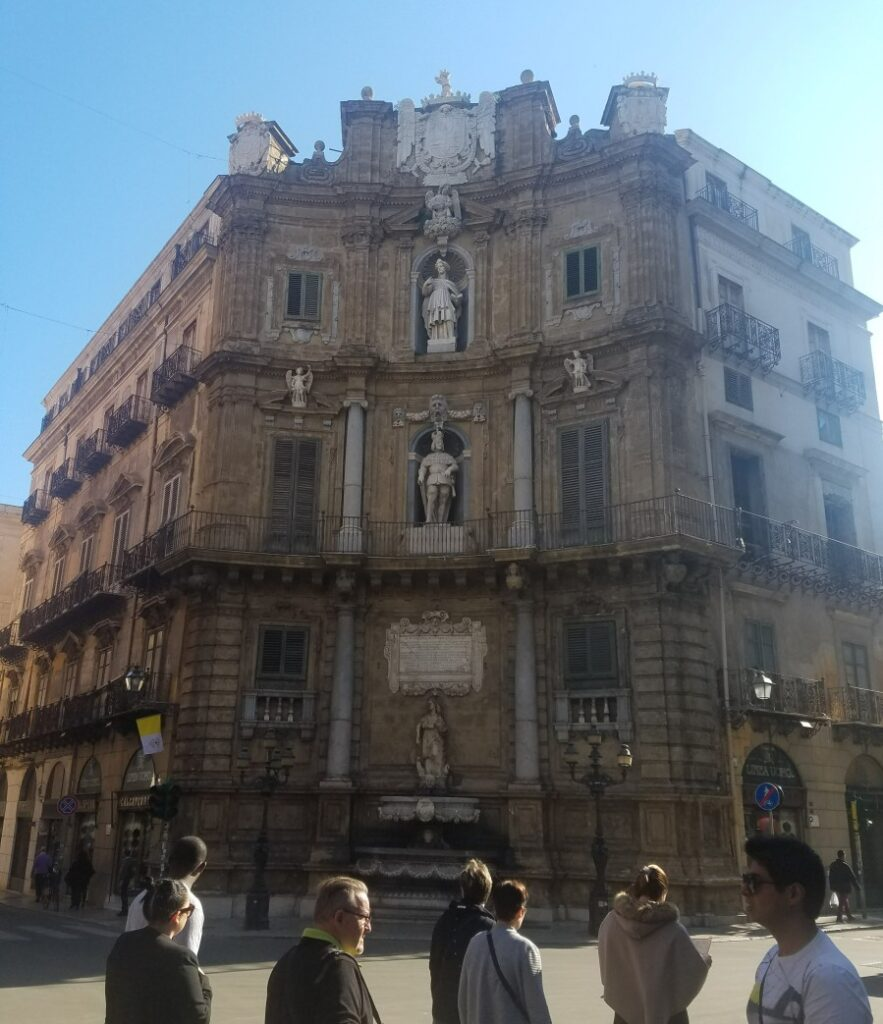 large building with sculptures on it Quatro Canti on a one day tour in Palermo