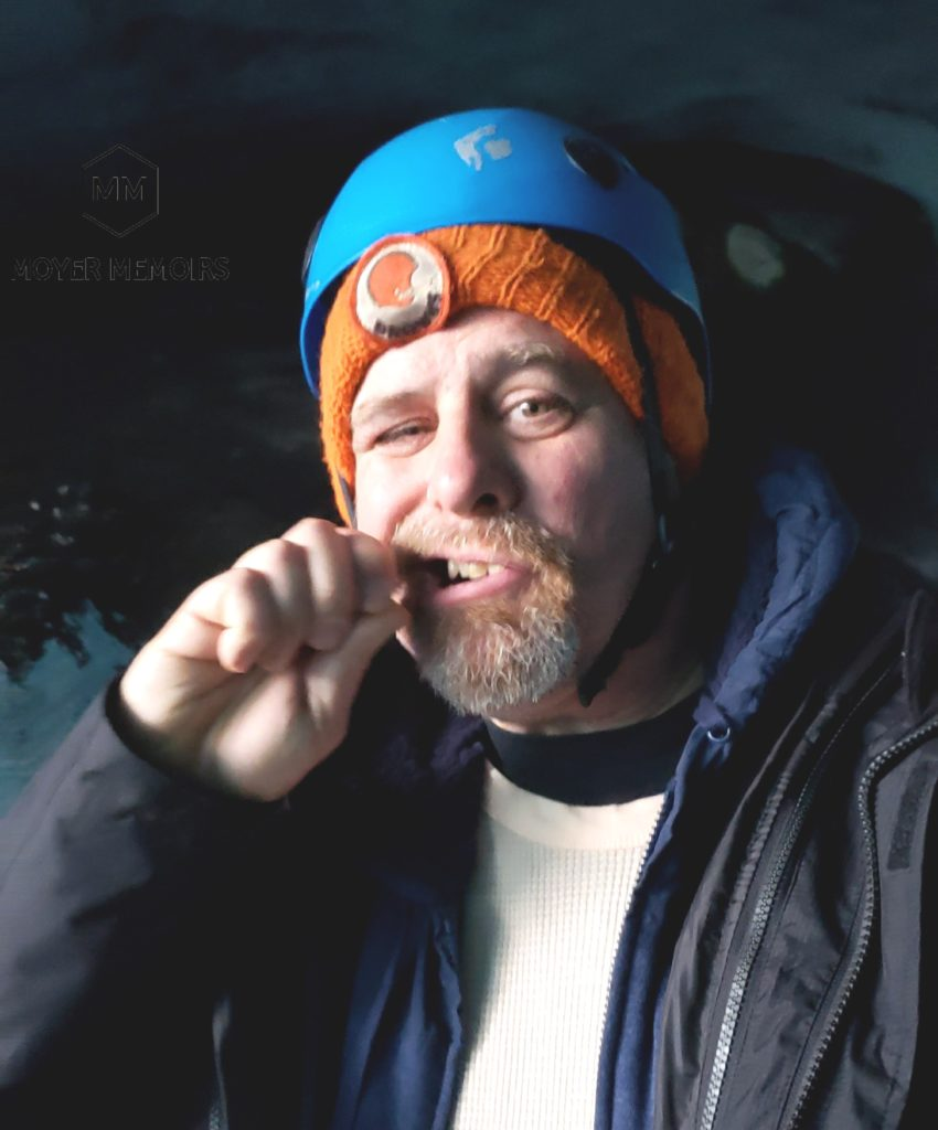 eating an icicle off of a glacier