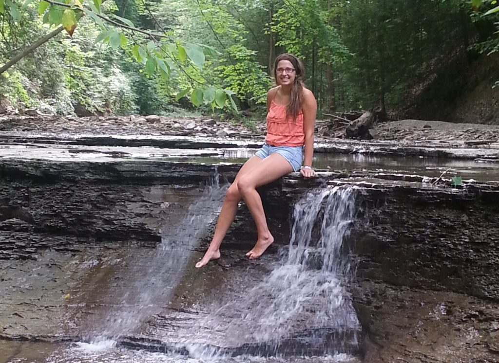 sitting in the creek at a waterfall