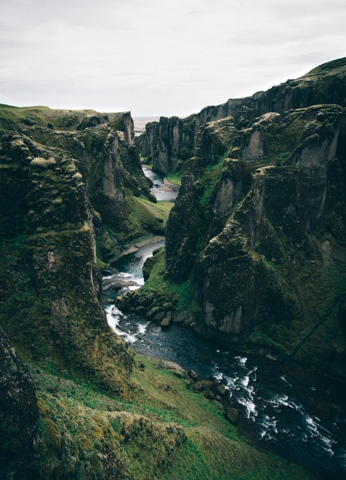 view of canyon with water running through it in Iceland