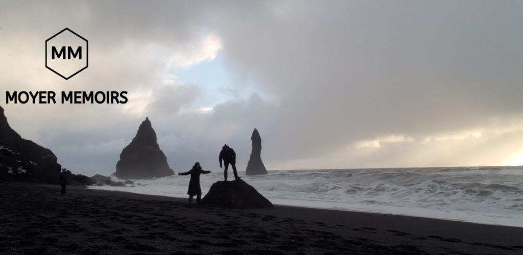 silouettes in front of Reynisfjara Sea Stacks