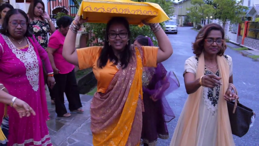 carrying temple tray at maticoor ceremony in Hindu wedding in Trinidad