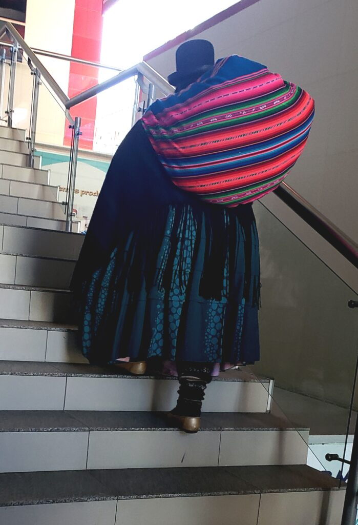 woman with colorful blanket on her back