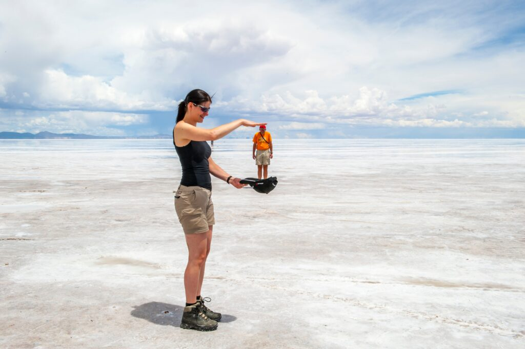 perspective pic of a couple in the salt flats