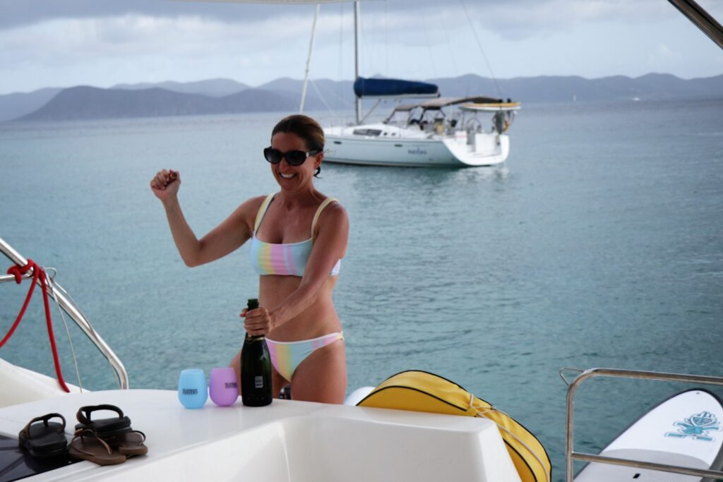 opening a bottle of wine on a boat at sea