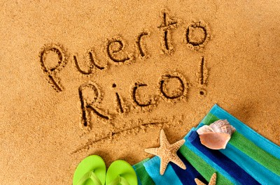 Puerto Rico written in the sand