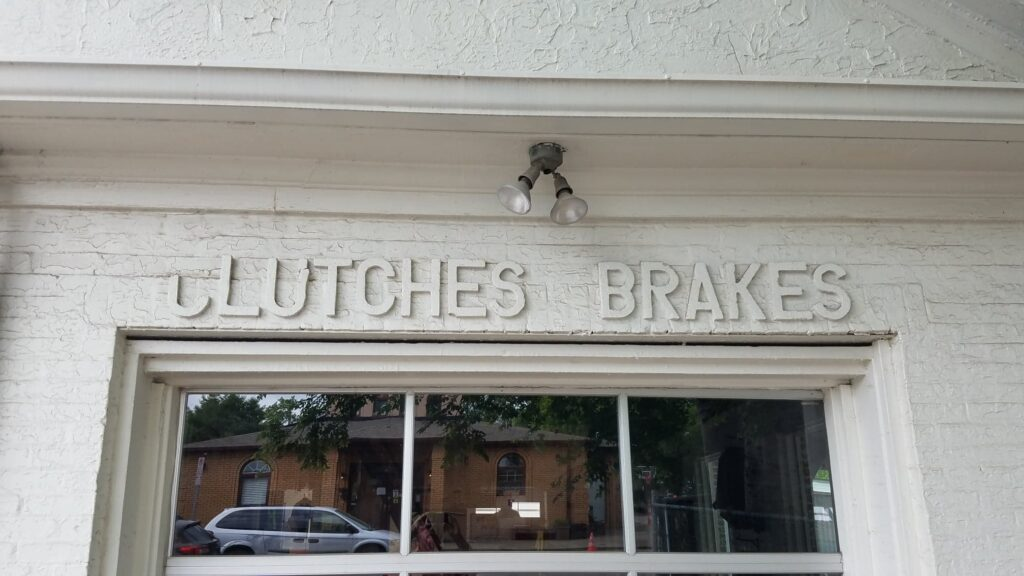 antique gas station sign for brakes at a shop on 12 South