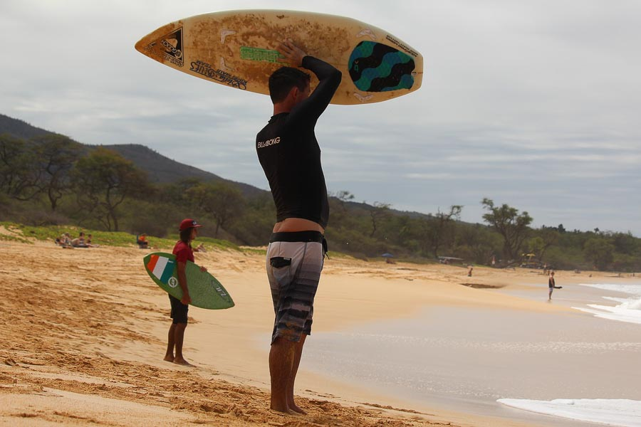 surf boarders on the beach in Maui