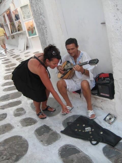 playing music on a street in Greece