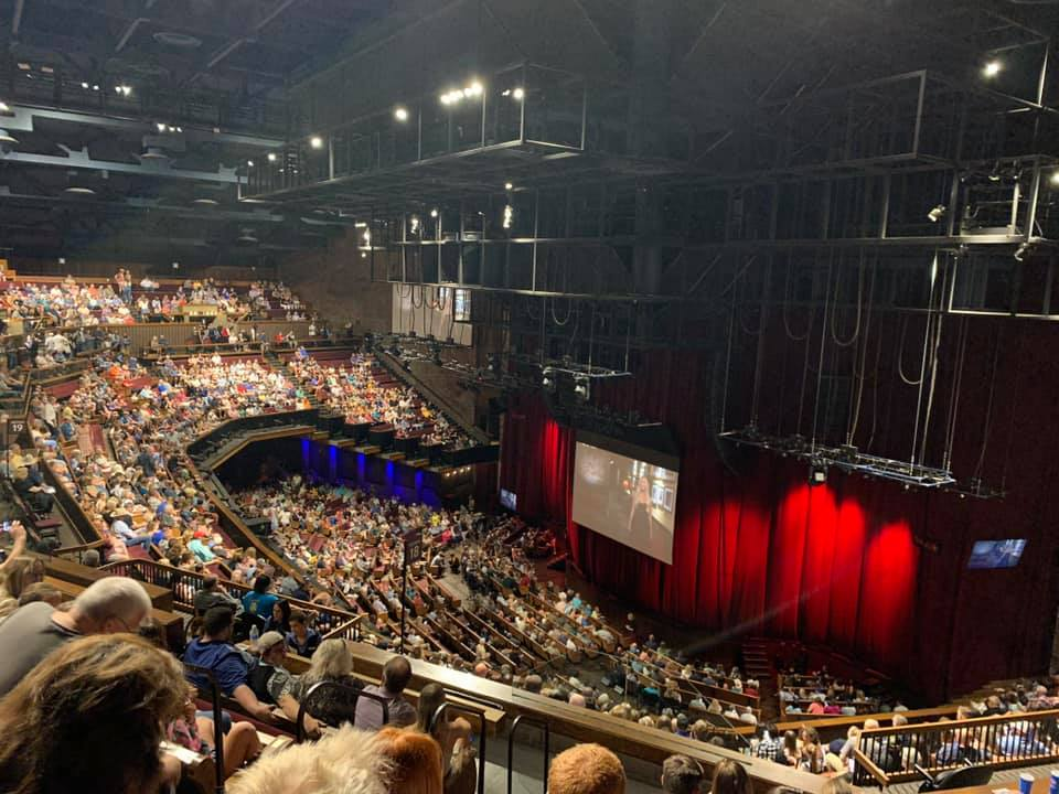 Inside audience looking at stage at the Grand Ole Opry in Nashville