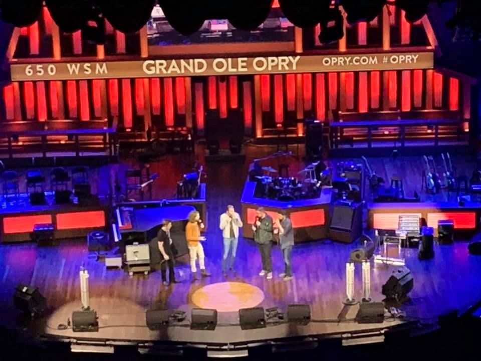 performers on stage at the Grand Ole Opry in Nashville