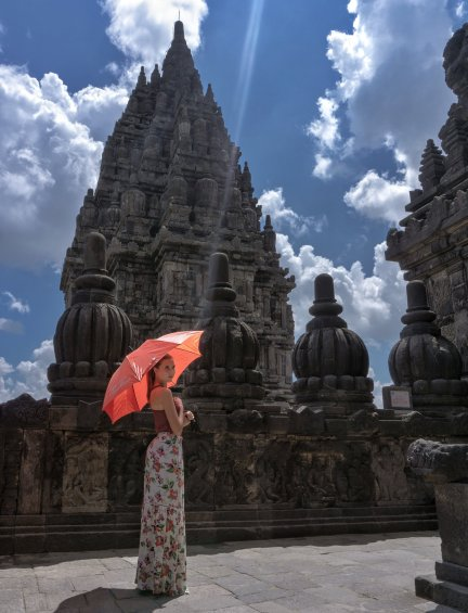 hindu temple in indonesia with girl and umbrella
