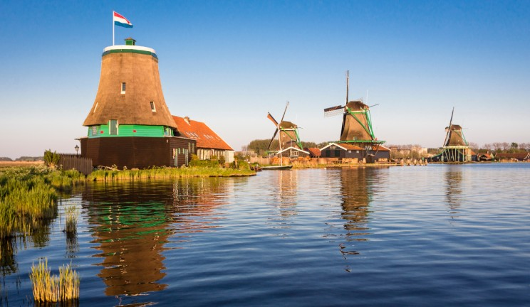 windmills on the water in the netherlands