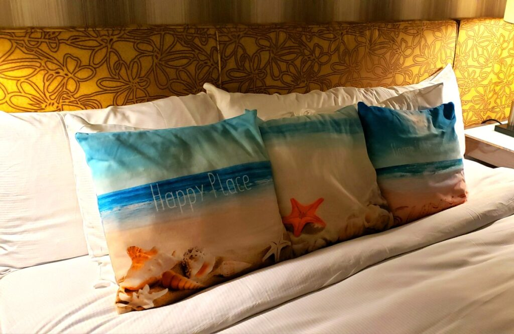 lots of pillows on a bed at the Curtis Hotel in downtown Denver