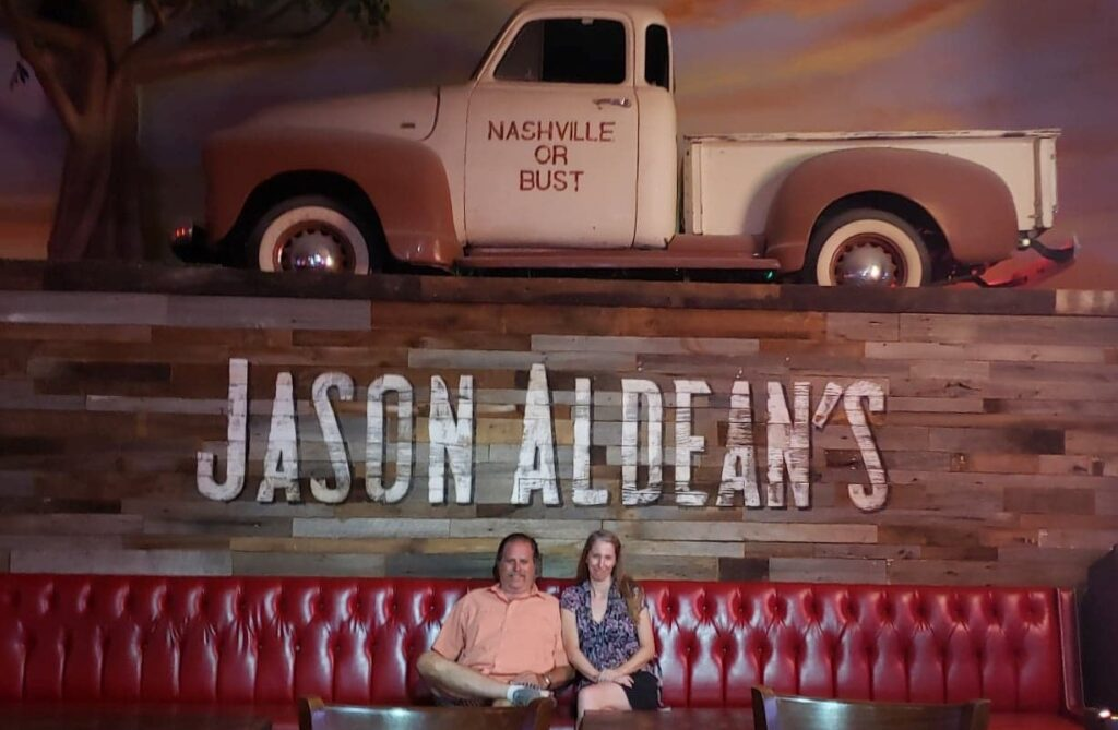 seated on a couch at Jason Aldeens bar and Restaurant on Honky Tonk Highway in NAshville