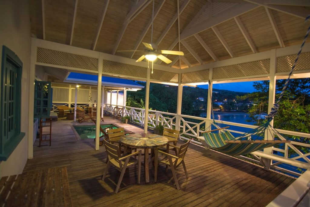 outside balcony and sitting area at Licorish by the sea - balcony- Guest houses in Tobago