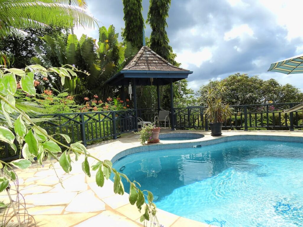 pool and gardens at Mock Turtle Bungalow - guest house in Tobago with pool