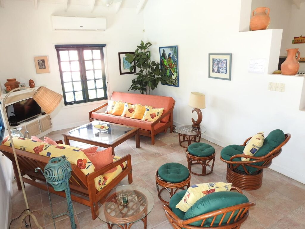 chairs and couches at Mock turtle bungalow - sitting room- Tobago guesthouses