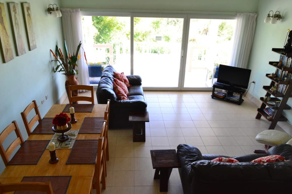 couch and sliding doors at Modern Villa in Tobago - sitting room