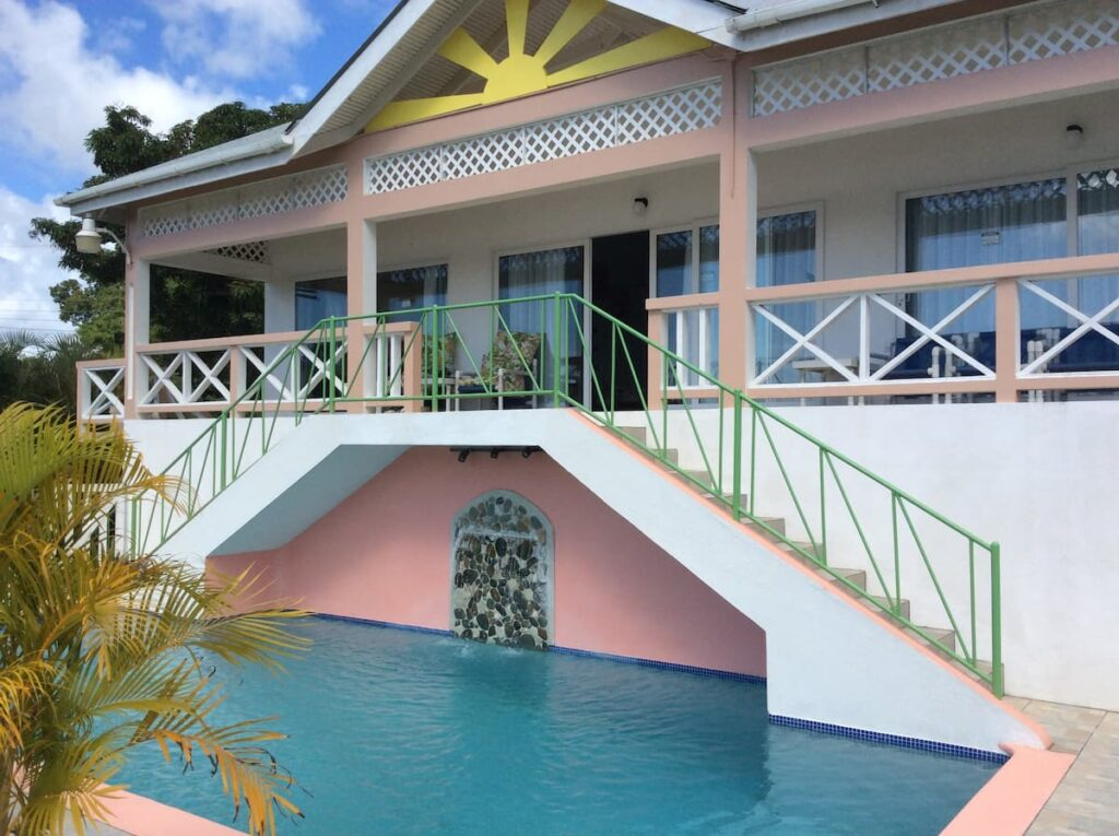 pool and entrance to guest house at Modern Villa to rent in Tobago