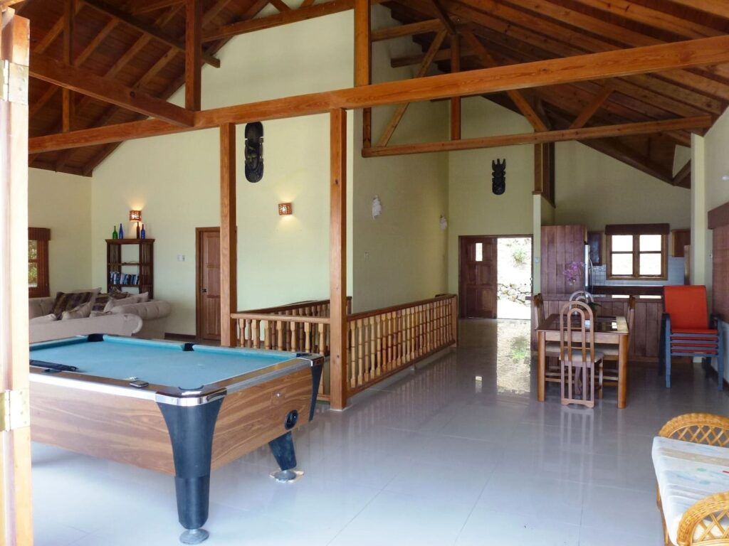 pool table and large interior of Mot Mot Luxury Lodge-game room- Guest houses in Tobago