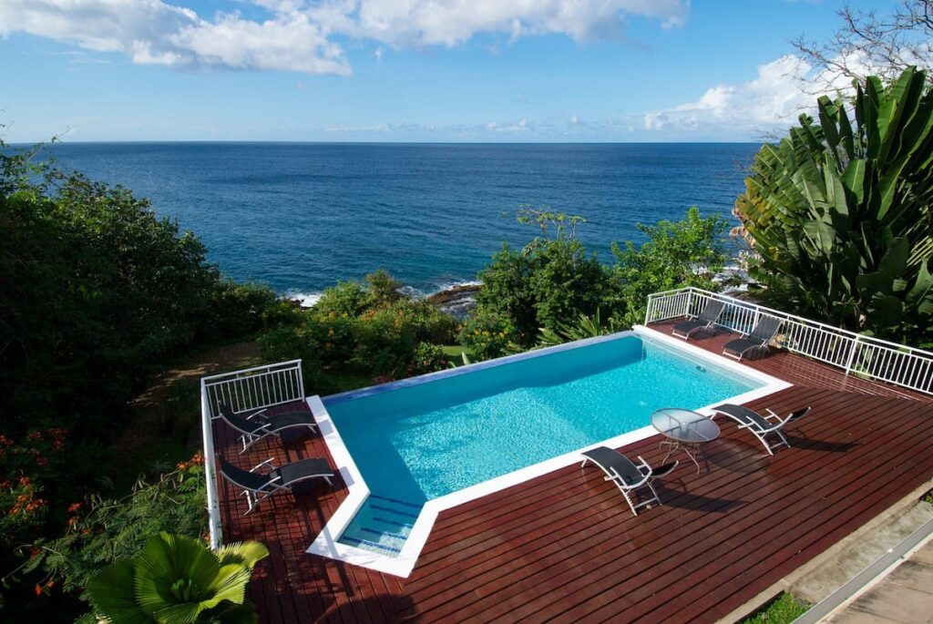 pool overlooking the sea at Mot Mot Luxury Lodge- guest houses in Tobago