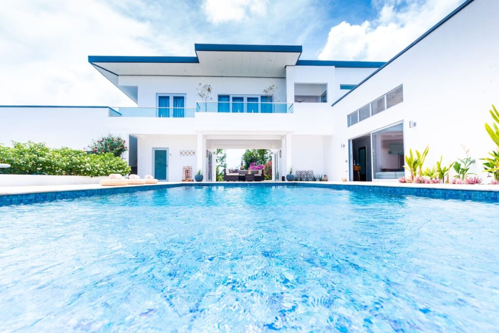 view of pool and guest house at Nirvana Luxury Villa airbnb in Tobago with pool