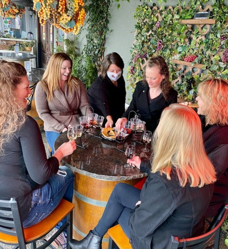 group gathered around a table on patio at Sumner Crest Winery on a weekend in Nashville