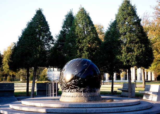 large globe war memorial in front of trees at bicentennial park in Nashville Tennessee