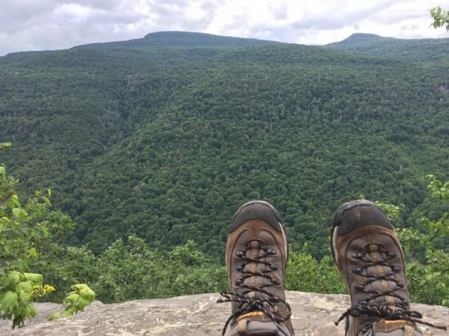 feet overlooking green mountain scenery at the catskills for an empty nest USA travel bucket list