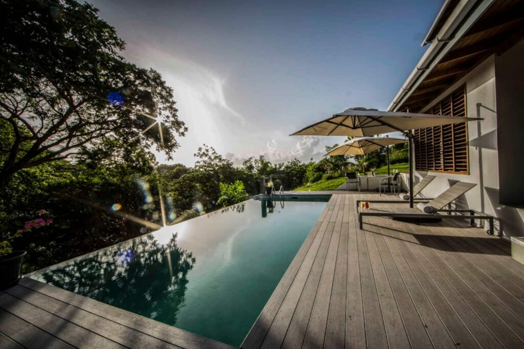 pool and greenery at firefly treetop villa-pool-apartment in Tobago with pool