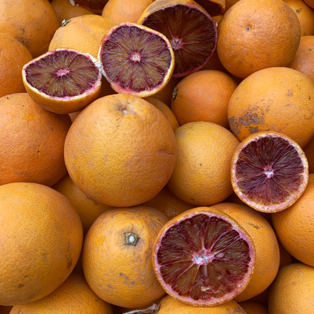 lots of oranges with red pulp - popular Palermo street market food