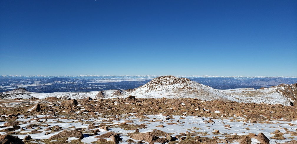 rocks and mountain view at the summit after driving pikes peak