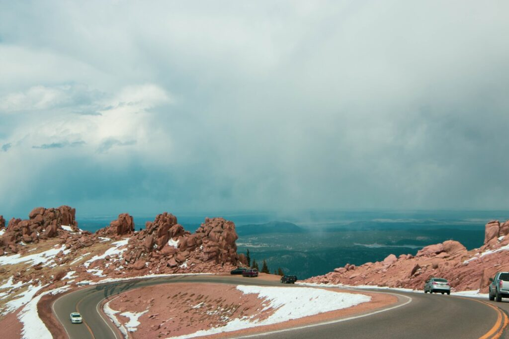 turns in the mountain road driving up Pikes Peak