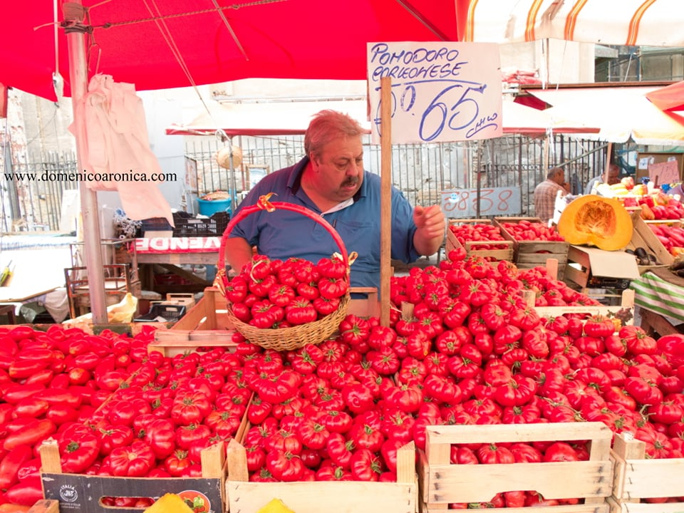 Tomatoes and a Fruit market vendor in Palermo