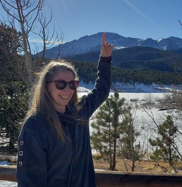 Pointing to the mountain that we drove to get to the summit of Pikes Peak
