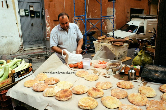 Man making Pane cunsato at Palermo street market in Sicily