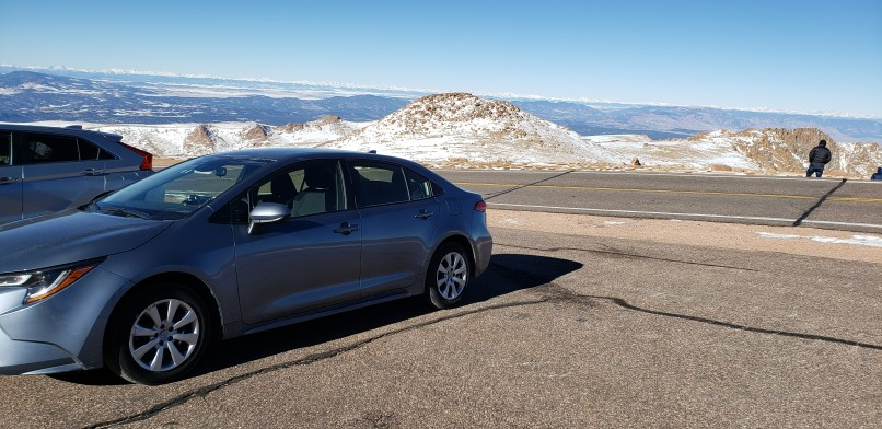 car parked in pull off area while driving up Pikes Peak in Colorado