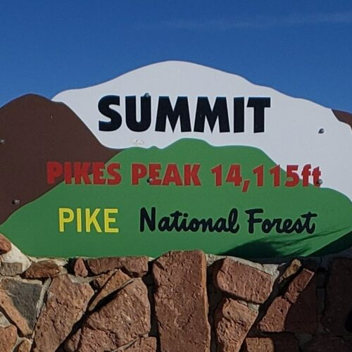 Sign at the summit after driving pikes peak