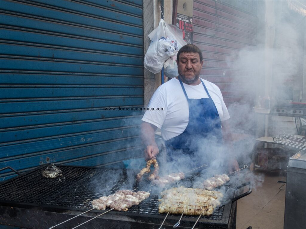 Man at a grill - Vendor of stigghiola at Palermo Street Food Market