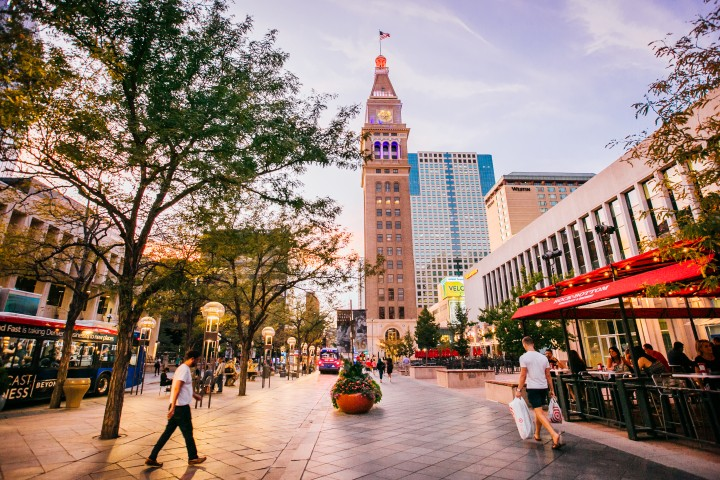people walking around 16th street mall on a denver itinerary