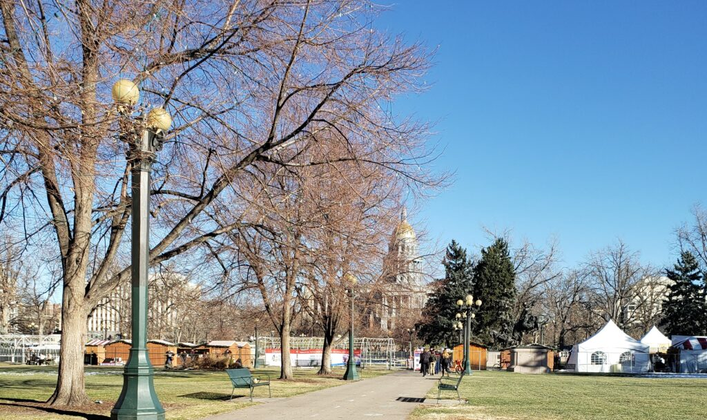 Park area with market booths in Denver