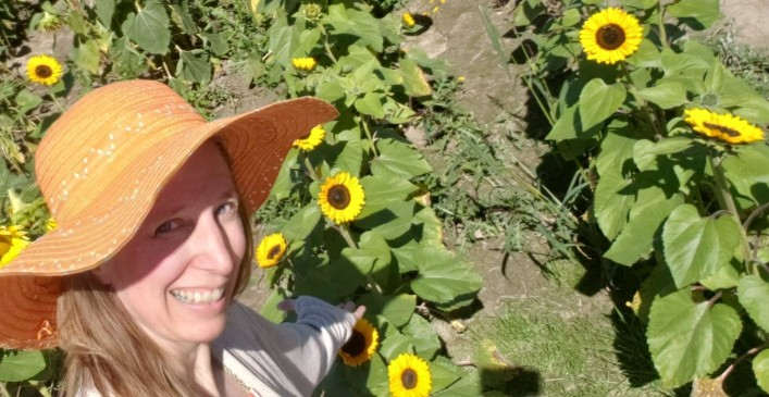 pointing to a field of sunflowers in ohio