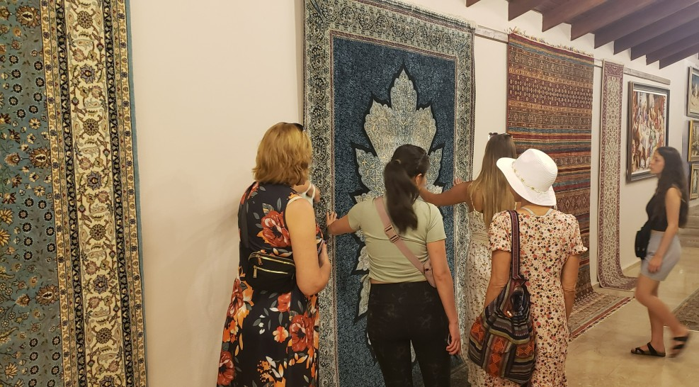 large turkish rugs hung on a wall in a rug warehouse in turkey